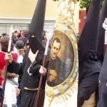 Nazarenos con estandarte de Don Bosco
